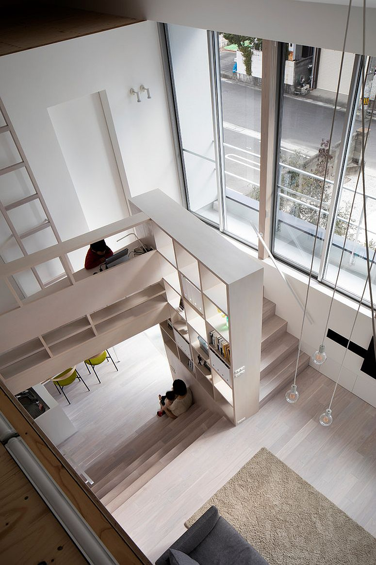 Stairway railing is turned into storage opportunity with box-styled shelves in this Japanese apartment