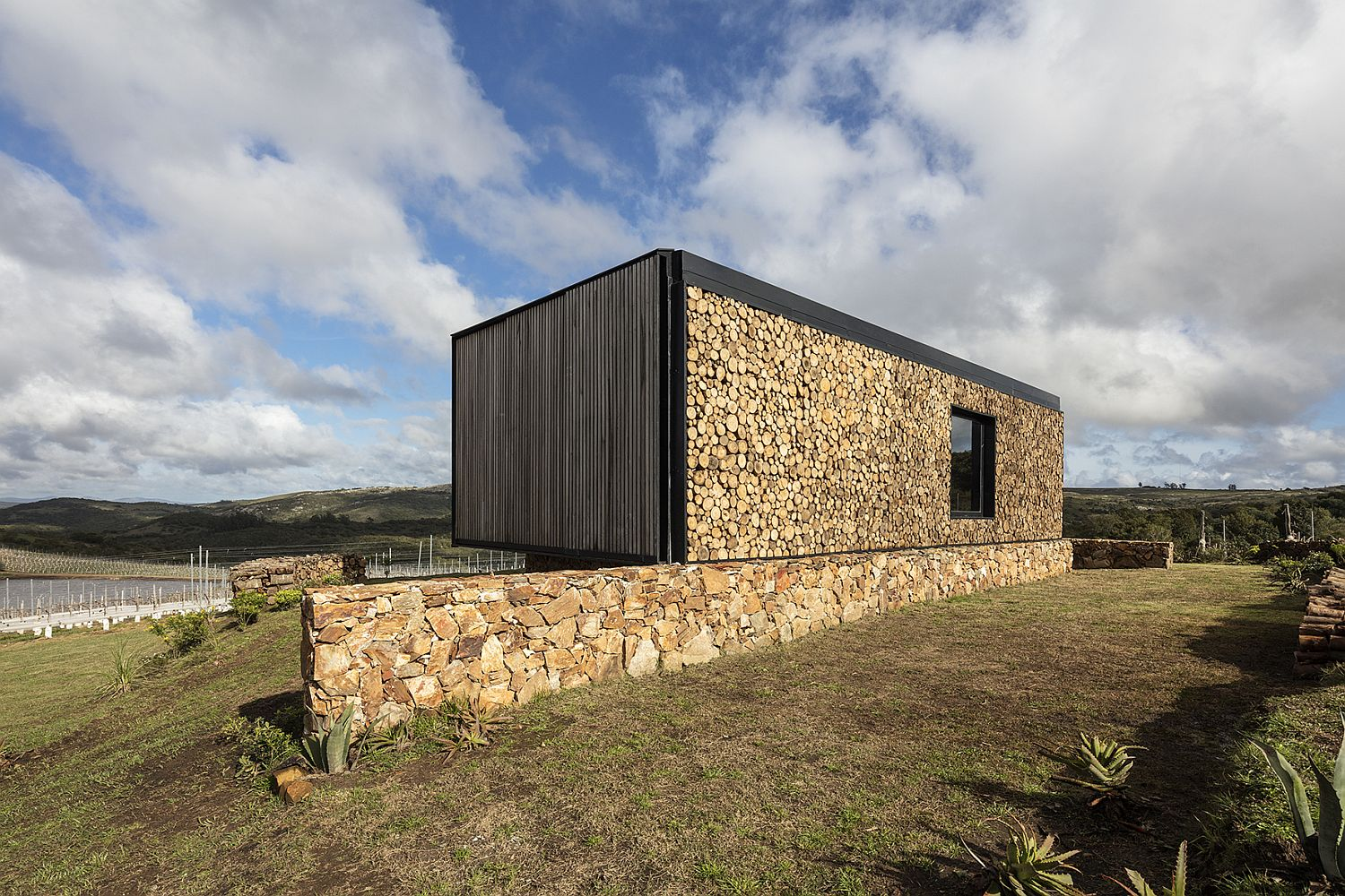 Stone-glass-and-wood-extreior-of-the-engrossing-cabin