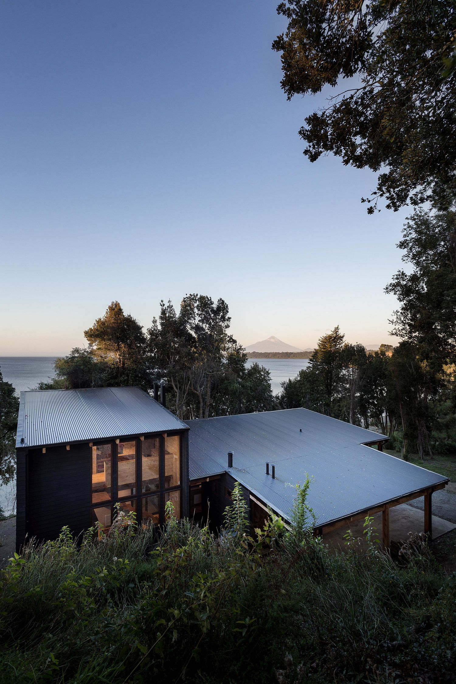 Stunning contemporary home in Chilean Patagonia with a gorgeous lake next to it