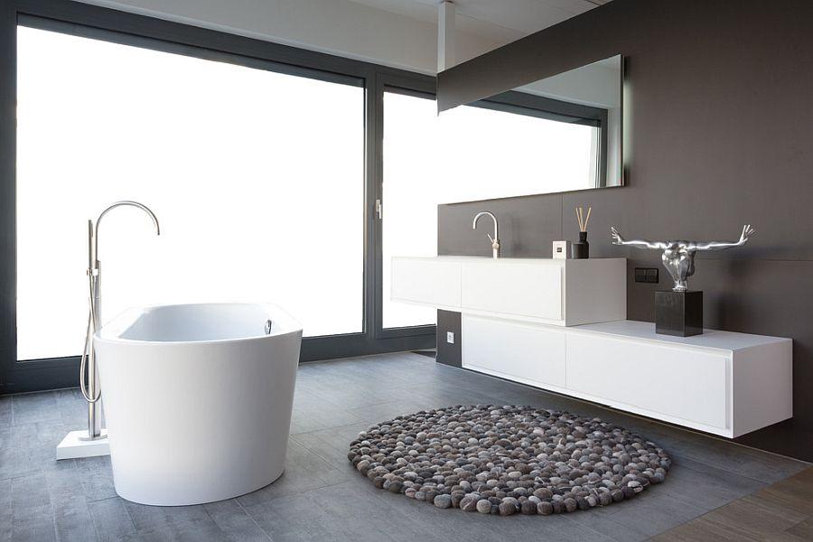 Stunning minimal bathroom with concrete floor