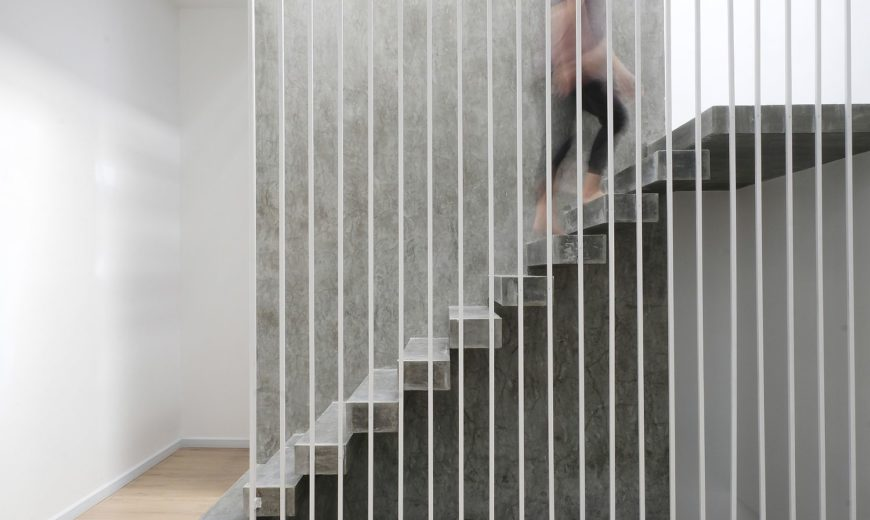 Raw Concrete Staircase Steals the Show Inside this Narrow Home!