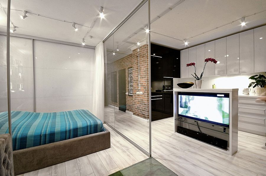 Tiny-bedroom-with-glass-walls-and-drapes-combines-openess-with-privacy