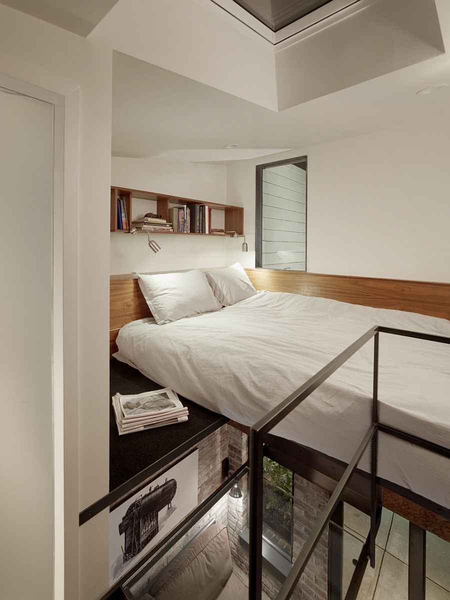 Tiny-loft-level-bedroom-of-the-guest-apartment-inside-the-revamped-1916-boiler-room