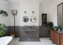 Whitewashed-brick-walls-coupled-with-concrete-inside-the-spacious-contemporary-bathroom-217x155