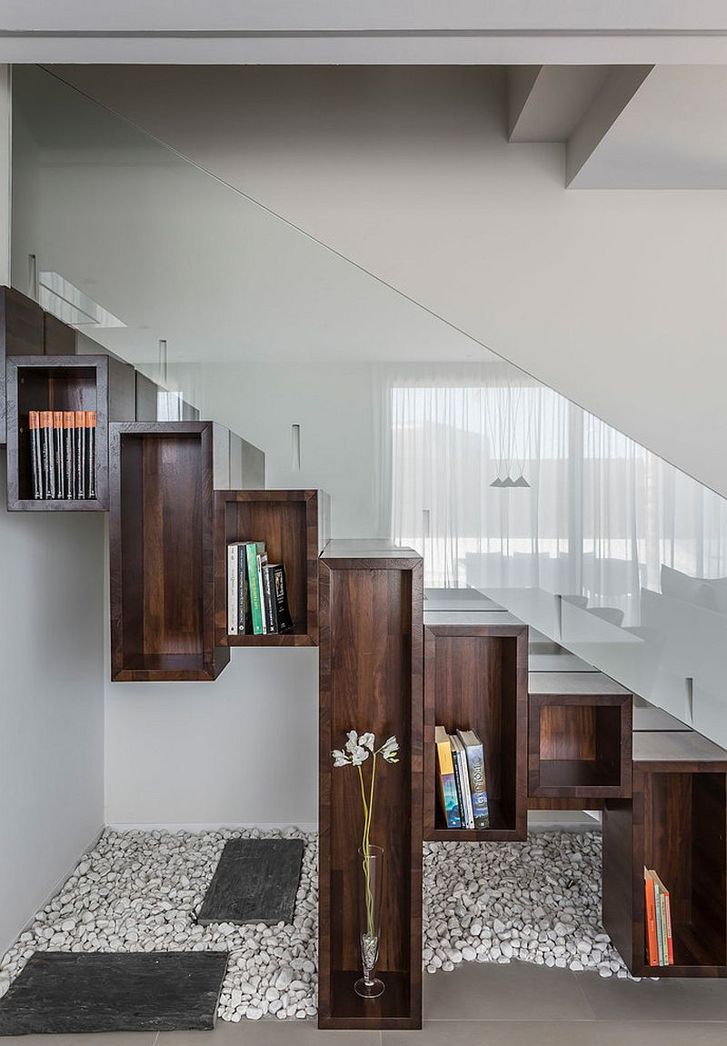 Wooden boxes turn the space under the stairway into a cool display