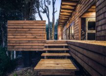 Wooden-steps-leading-to-the-extensive-deck-around-the-home-217x155