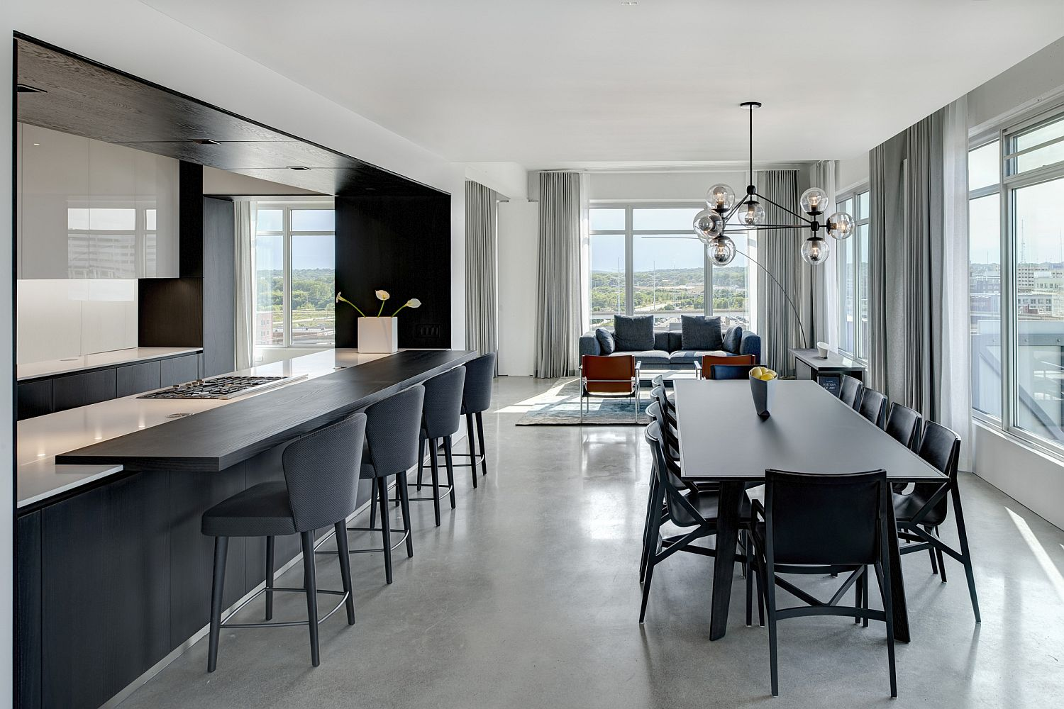 Open living area in white with gray kitchen and dining space