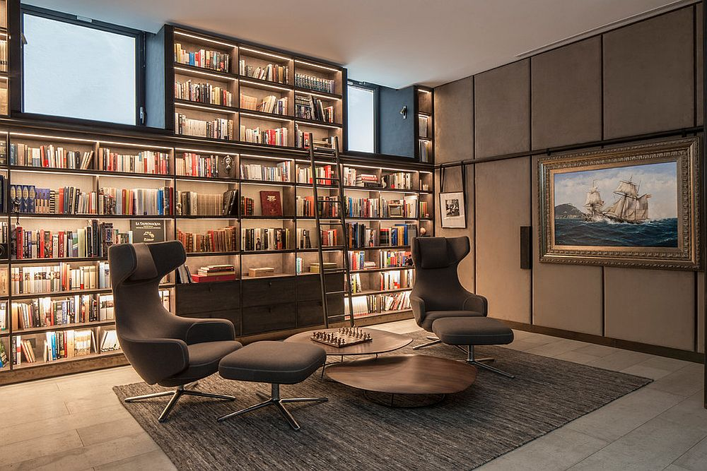 A wall of shelves for the booklover inside the polished contemporary home office
