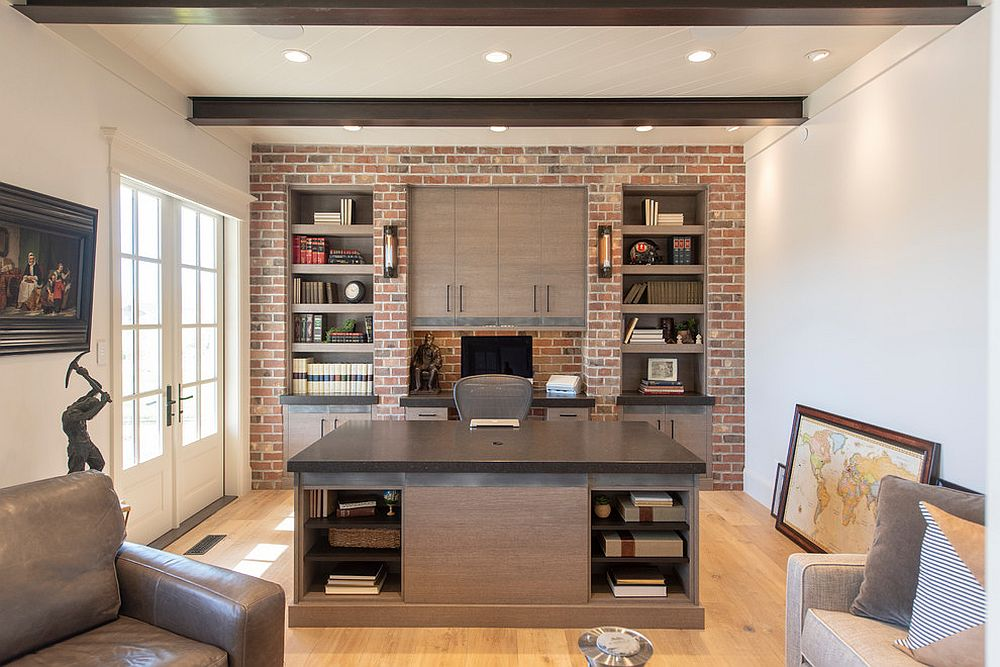 Accent brick wall with bookshelves for the modern industrial home office