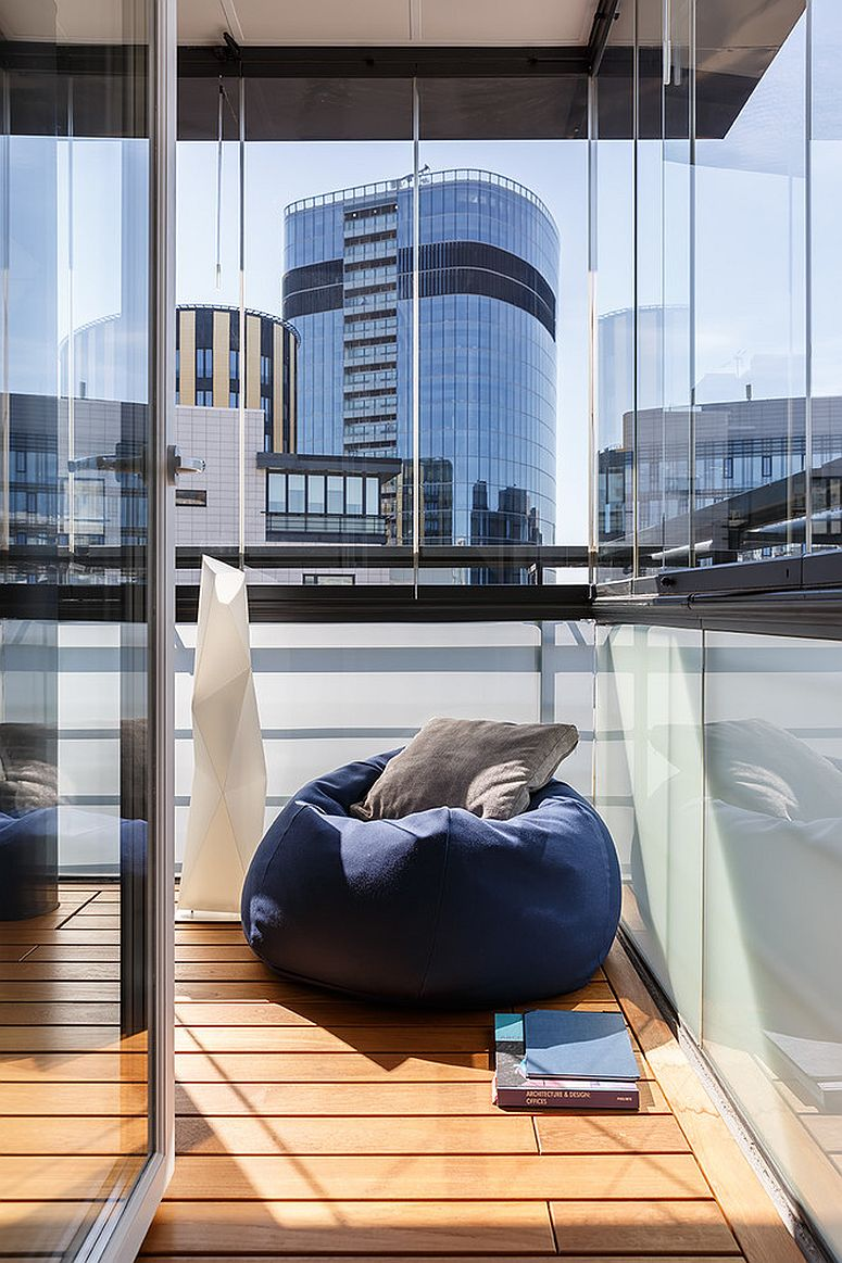 Bean bag in the corner of the contemporary deck provides a relaxing hangout