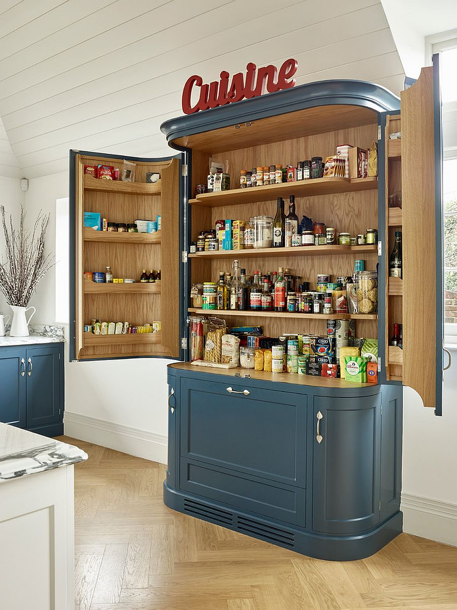 Beautiful and unique custom pantry in blue stands on its own