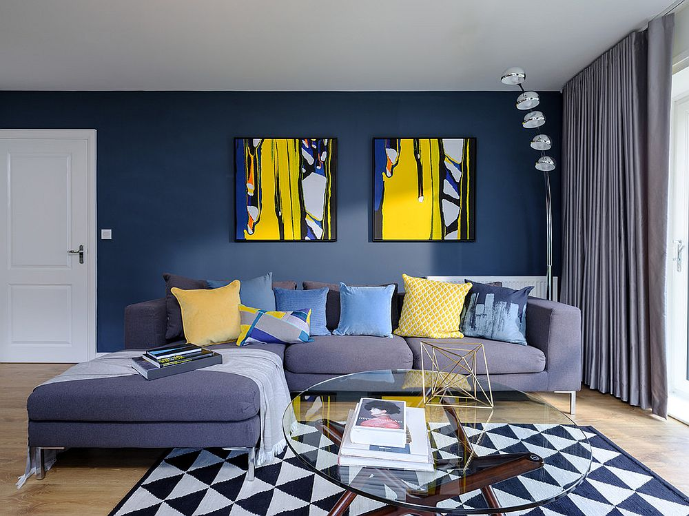 Beautiful contemporary living room in blue with a geo rug
