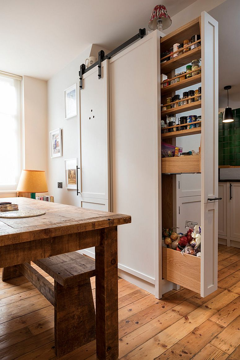 Bespoke pull-out system provides all the necessary storage space inside this modern kitchen