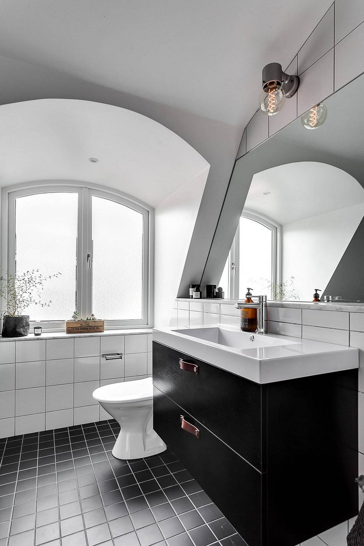 Black and white Scandinavian style bathroom filled with natural light