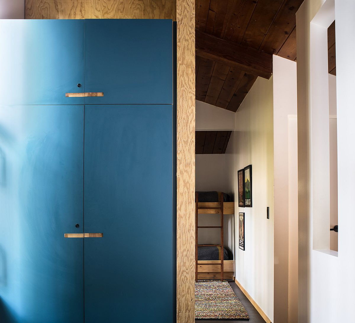 Blue closet doors give the bedrooms a more organized and polsihed look
