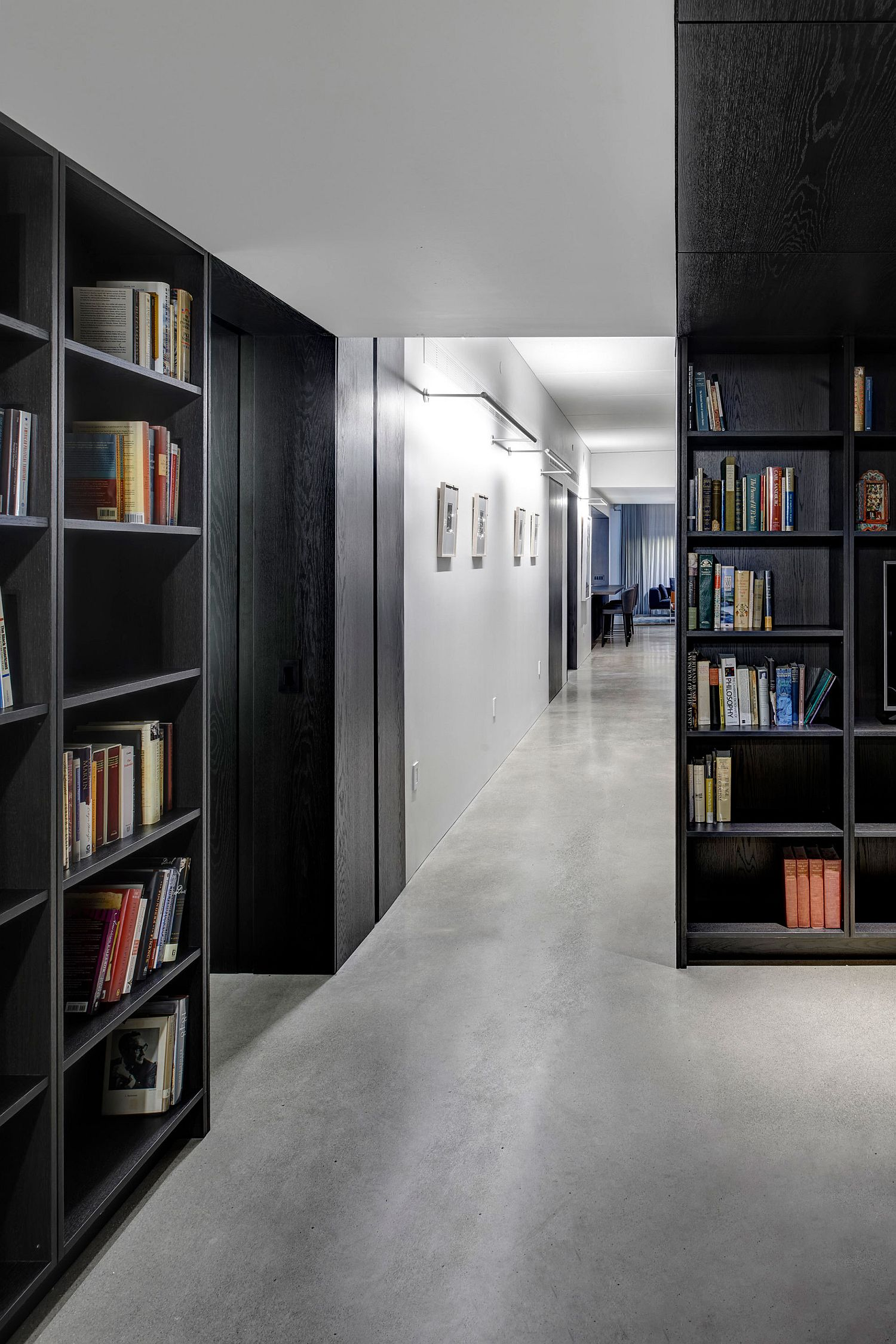 Bookshelves-crafted-using-dark-wooden-elements-make-a-big-impact