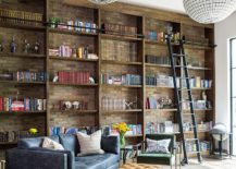 Brick-wall-in-the-backdrop-adds-beauty-to-the-open-shelves-in-wood-inside-the-home-office-217x155