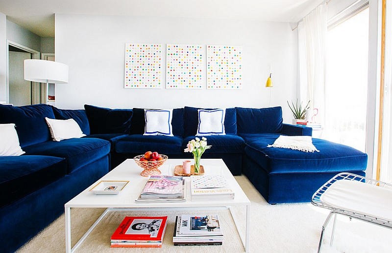 Bright and bold navy blue couch with a velvety finish