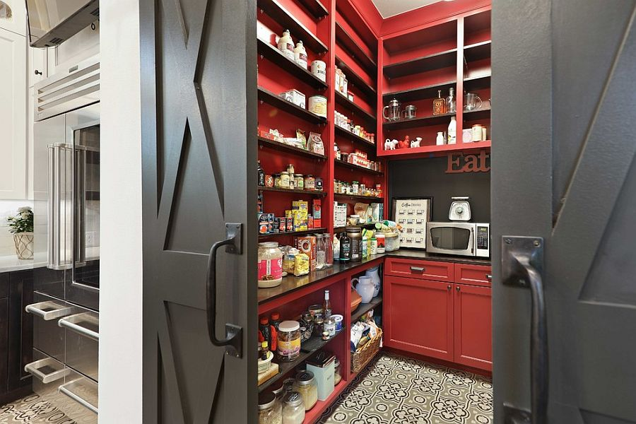 Bright and cheerful pantry in red with dark gray doors for the farmhouse kitchen