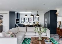 Bright-green-and-black-rug-adds-color-and-apttern-to-this-spacious-living-room-217x155