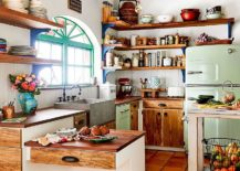 Clever-open-shelves-make-wonderful-use-of-corner-space-in-this-kitchen-217x155