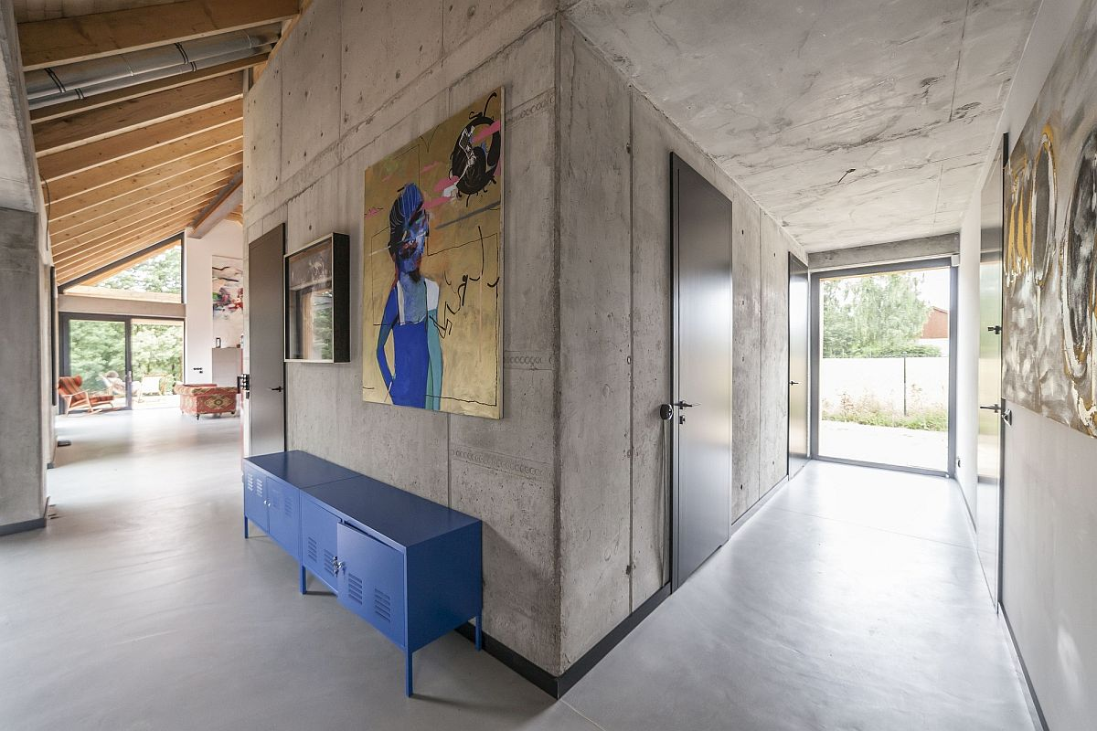 Concrete walls of the house enlivened by pops of blue