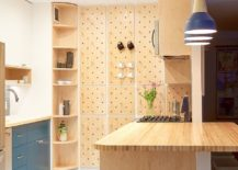 Contemporary-kitchen-with-pegboard-wall-offers-ample-storage-space-217x155