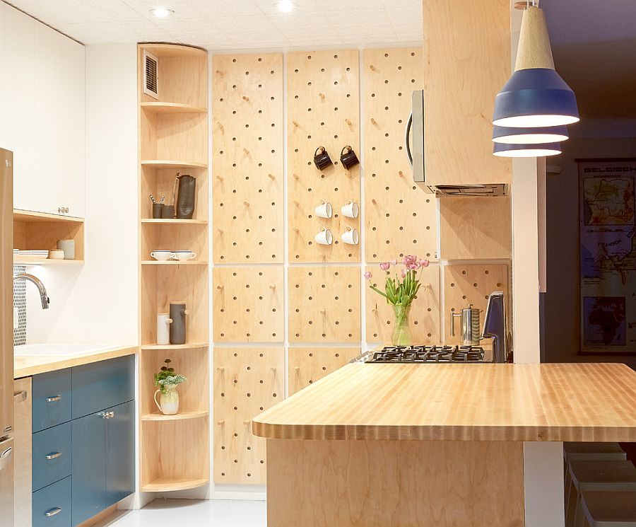 Contemporary kitchen with pegboard wall offers ample storage space