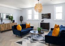 Contemporary-living-room-with-a-geometric-rug-and-bright-blue-sofas-217x155