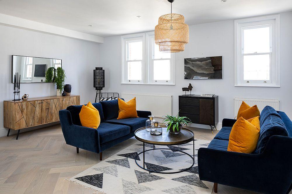 Contemporary living room with a geometric rug and bright blue sofas