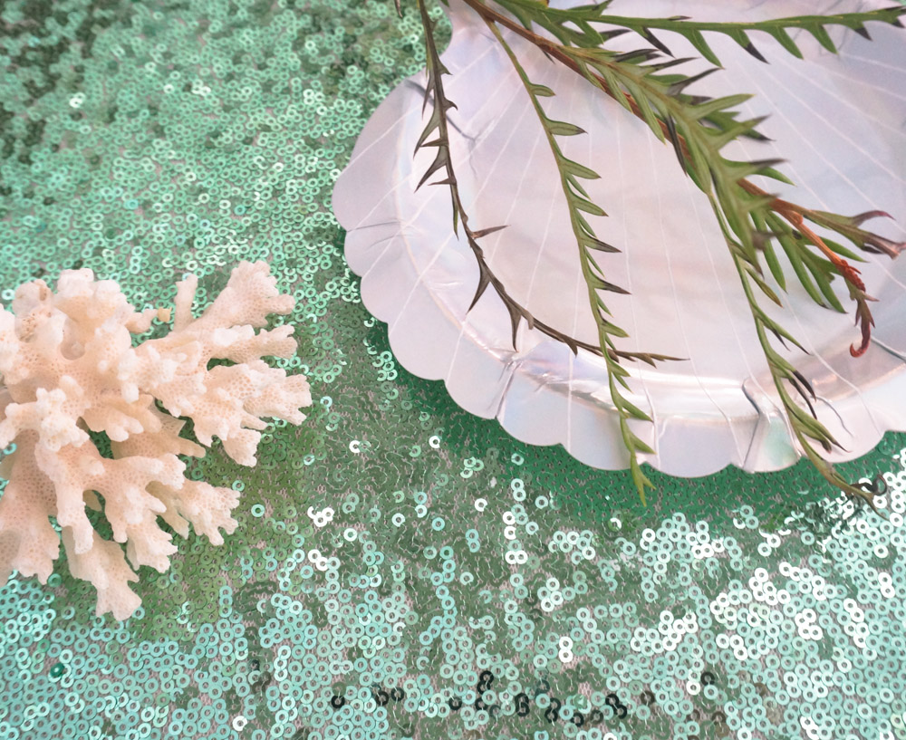 Coral and greenery create a summer sea vibe