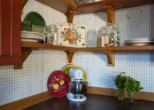 Corner-of-the-rustic-kitchen-turned-into-storage-space-using-pegboard-on-the-walls-217x155