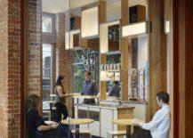 Corner-windows-and-elegant-birch-wood-seating-inside-Blue-Bottle-South-Park-217x155