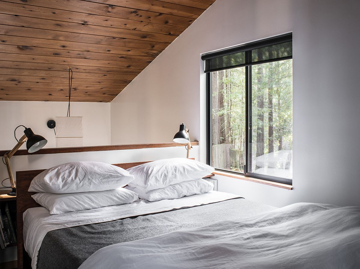 Cozy and space-savvy bedroom in wood and white