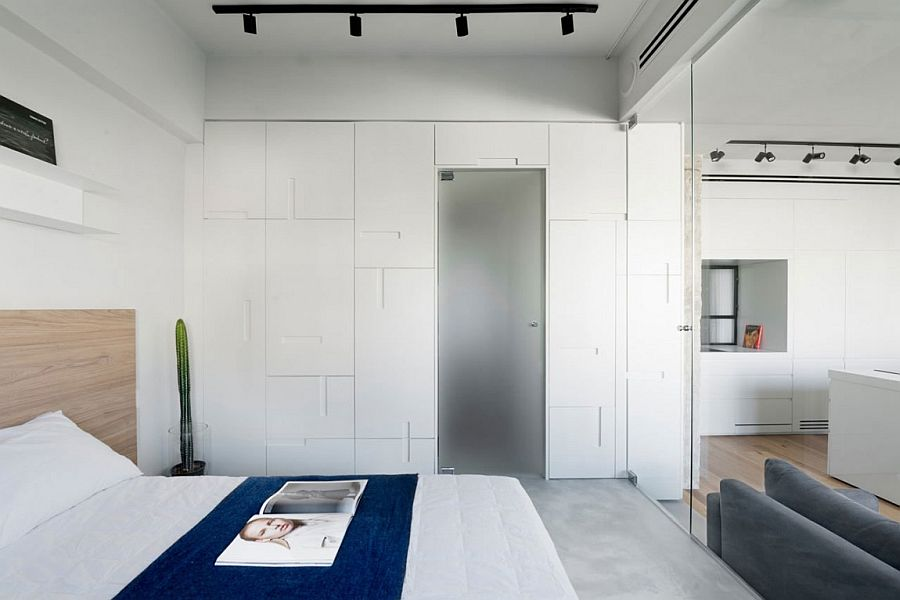 Custom cabinets in white for the bedroom blend in with teh backdrop