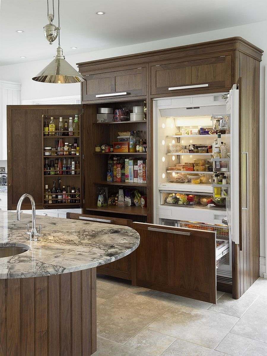 Custom unit houses pantry that offers plenty of storage area for everything in the kitchen