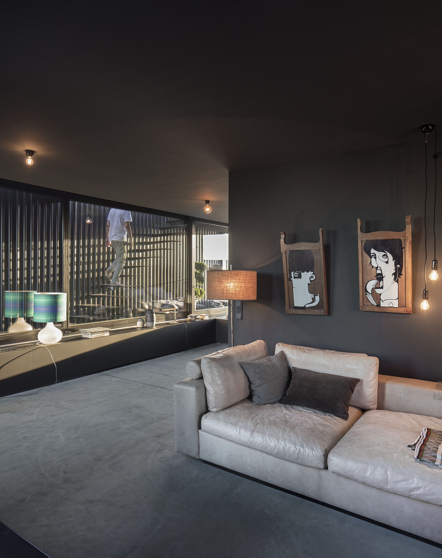 Dark gray and black give the penthouse interior a unique, sophisticated vibe