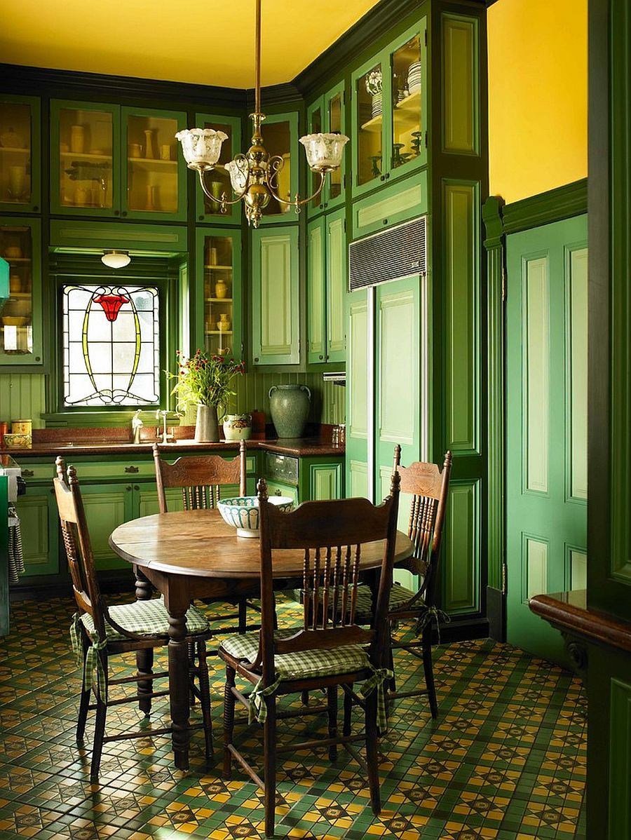 Dark green and yellow dining room with Victorian style