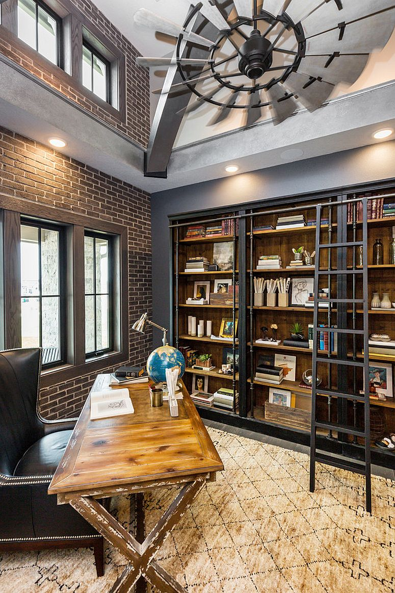 Double height industrial home office with brick wall