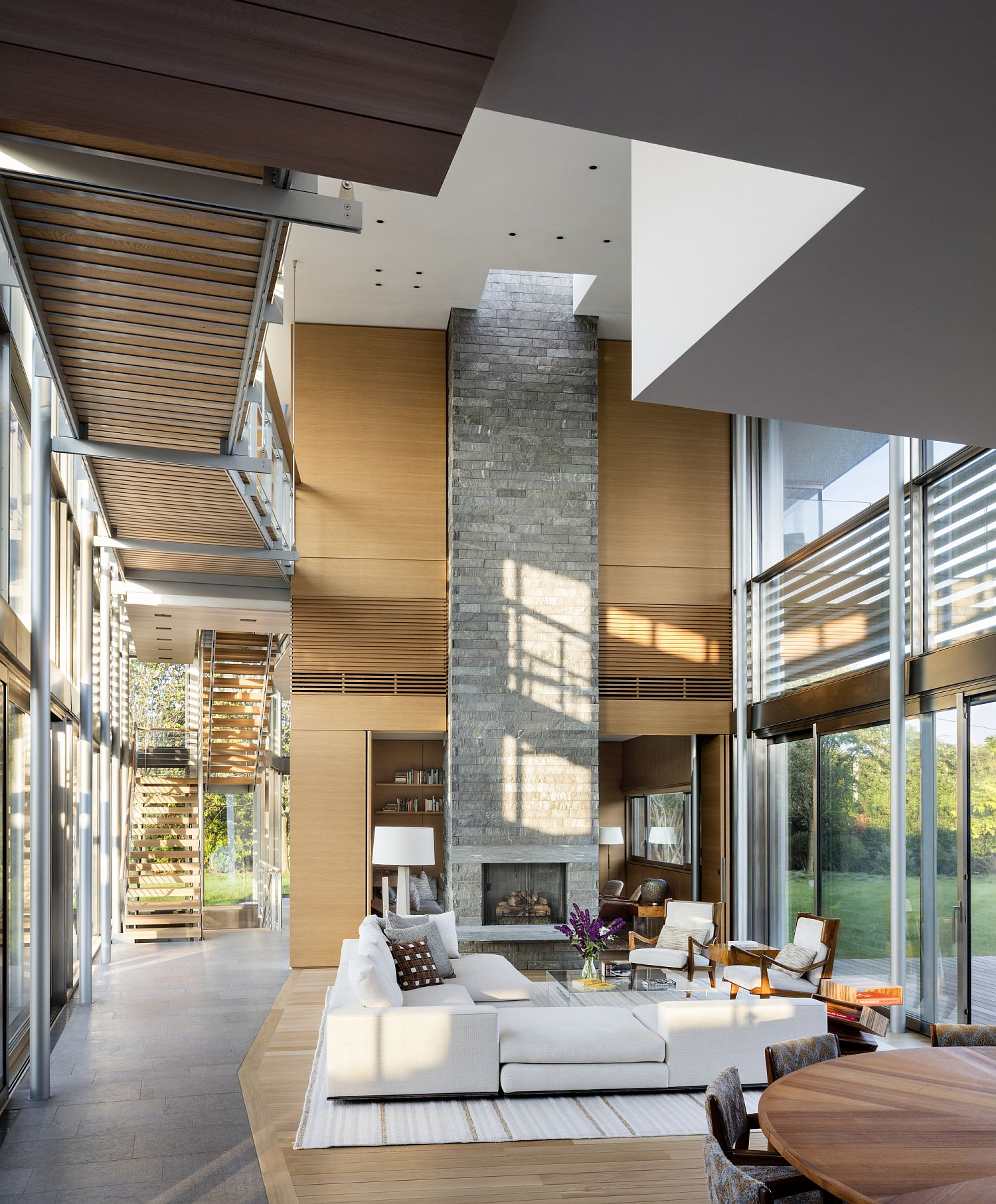 Double height living area and dining space of the Hamptons Residence