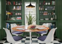 Eclectic-dining-room-in-dark-green-with-ample-shelving-217x155