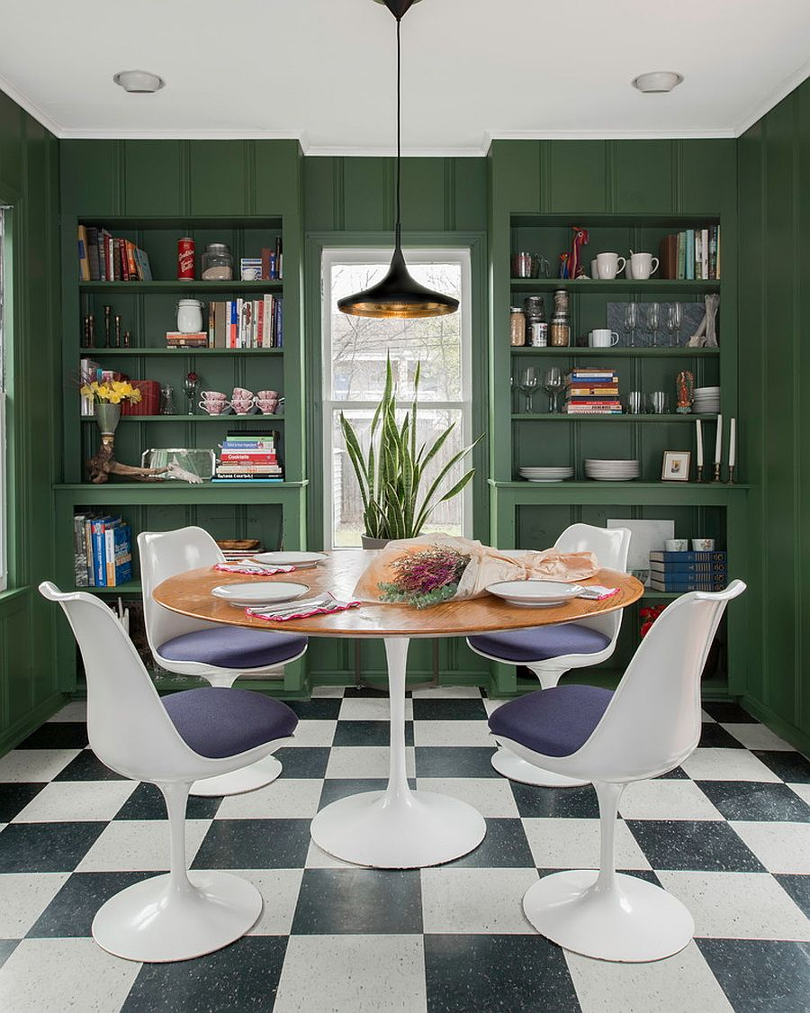 Eclectic dining room in dark green with ample shelving