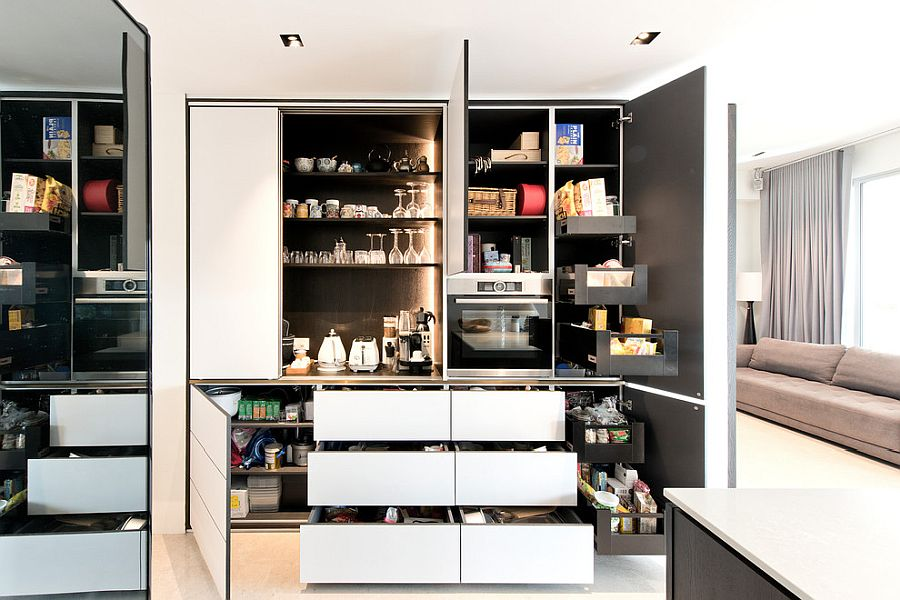 Exquisite contemporary pantry with pull-out cabinets and ample storage space
