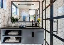Geometric-wall-covering-and-floating-vanity-for-the-modest-bathroom-217x155