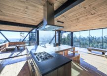 Glass-walls-and-the-wooden-deck-outside-give-this-kitchen-an-open-vibe-217x155