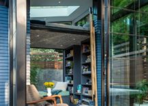 Glazed-sliding-glass-doors-connect-the-shed-with-the-deck-outside-217x155
