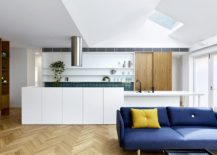 Goregous-blue-sofa-at-the-front-and-the-kitchen-at-the-back-with-colorful-tiles-paint-a-picture-of-modernity-217x155