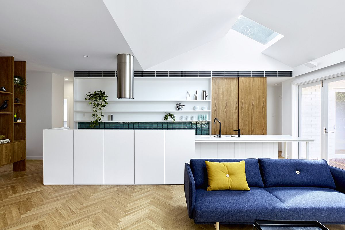 Goregous-blue-sofa-at-the-front-and-the-kitchen-at-the-back-with-colorful-tiles-paint-a-picture-of-modernity