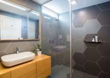 Gorgeous-hexagonal-bathroom-tiles-and-wooden-vanity-for-the-small-bathroom-217x155