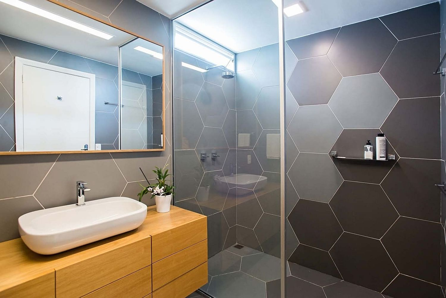 Gorgeous hexagonal bathroom tiles and wooden vanity for the small bathroom